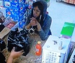 Surveillance video photo of an unknown woman who police say used credit cards belonging to Mark Bakotic II.