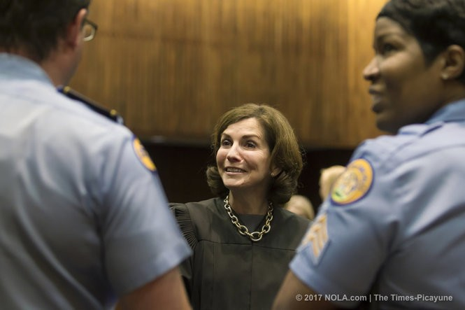 U.S. District Judge Susie Morgan, center, talks with New Orleans police officers, Lt. Terry St. Germain, left, and Sgt. Shawn Jenkins, right, who graduated from a peer intervention program called EPIC, Ethical Policing Is Courageous, during a pin ceremony at the Federal Court building on Poydras Street in New Orleans on Thursday, May 18, 2017. Morgan oversees NOPD's federal consent decree. (Photo by Chris Granger, NOLA.com | The Times-Picayune)