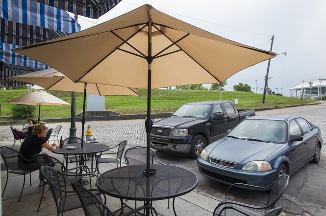 Patrons dine outside the Dry Dock Cafe in Algier's Point across from the ferry terminal along the Mississippi River on Thursday, August, 21, 2014. A man and woman stole meat and beer from the business just after midnight Thursday (March 22).