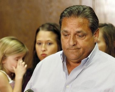 Surrounded by his family, Mandeville Mayor Eddie Price resigns on Oct. 9, 2009.