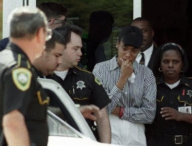 Antoinette Frank is escorted out of the Kim Anh restaurant after the jury in her September 1995 murder trial was given a tour of the murder scene.