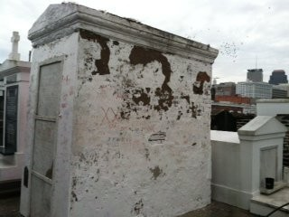 Angie Green with Save Our Cemeteries said the Archdiocese of New Orleans inflicted significant damage to the tomb of Marie Laveau by power washing off pink paint from a vandal. The pressure wash chipped off pieces of plaster and brick, Green said. (Photo from Save Our Cemeteries)
