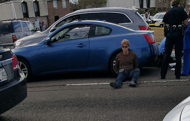 Ronald Gasser, who authrities say killed Joe McKnight, is seen sitting on the ground at the scene where he shot the ex-NFL player in Terrytown on Thursday, Dec. 1, 2016. (Handout photo)