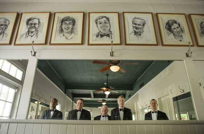 Clancys waiters Alton Risin, 35, Tommy Gerrets, 46, Artie McRae, 69, Michael Meeks, 71, and Jeffrey Groetsch, 58, are reflected in a mirror where pictures of well-known regulars hang from a wall. (Photo by Chris Granger, NOLA.com | The Times-Picayune)