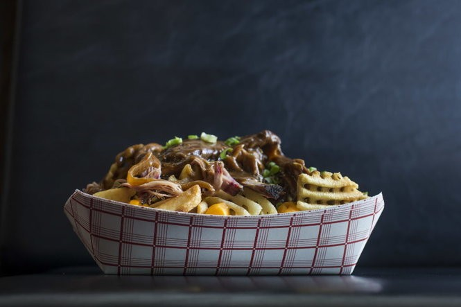 The BBQ Poutine at McClures BBQ features waffle cut French fries with Wisconsin cheese curds, pulled pork or brisket, house made gravy, and green onions. (Photo by Chris Granger, NOLA.com | The Times-Picayune)
