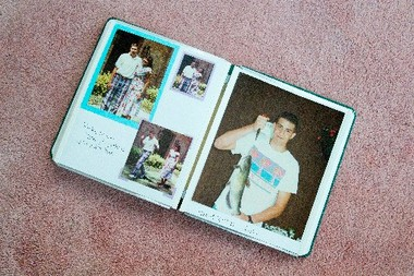 Virginia Blanke's scrapbook of her son's life is turned to the photo of Ricky with the fish he caught the day he committed suicide.