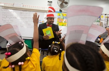Paul Habans students and then-principal Desmond Moore celebrate Dr. Seuss' birthday in March 2012.