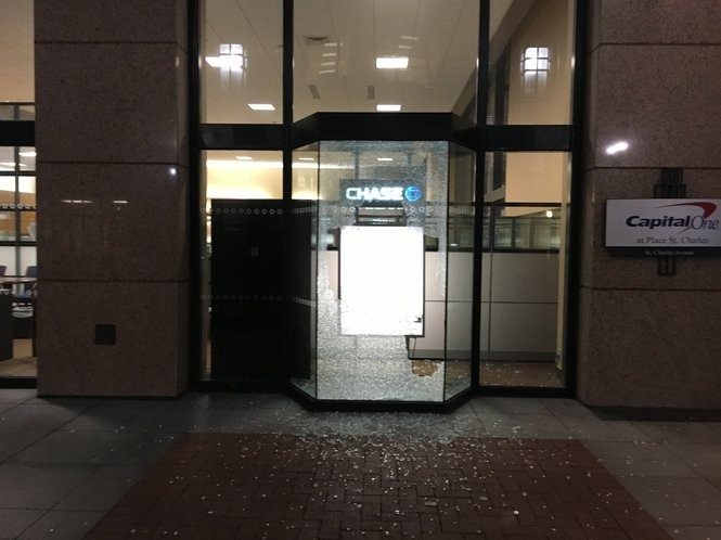 Shattered glass at a Chase bank on St. Charles Avenue. (Photo by Laura McKnight, NOLA.com | The Times-Picayune)