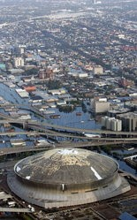 In this Aug. 30, 2005 file photo, the Louisiana Superdome in New Orleans is seen in this aerial view. The stadium, which was damaged by Hurricane Katrina, sits surrounded by floodwaters.