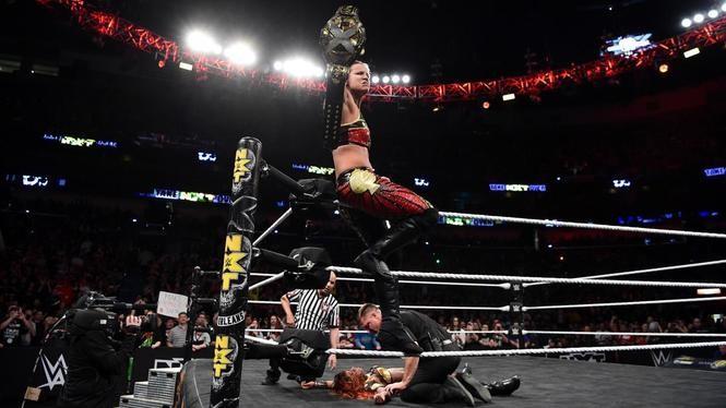 Shayna Baszler celebrates winning the NXT women's title.