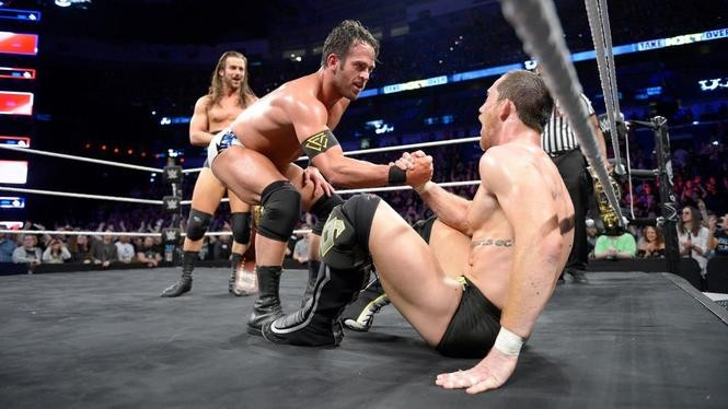 Roderick Strong, middle, joined The Undisputed Era on Saturday night in helping the group retain the NXT tag team titles. Adam Cole, left, won the NXT North American title, and Kyle O'Reilly is overjoyed with the group's new addition.