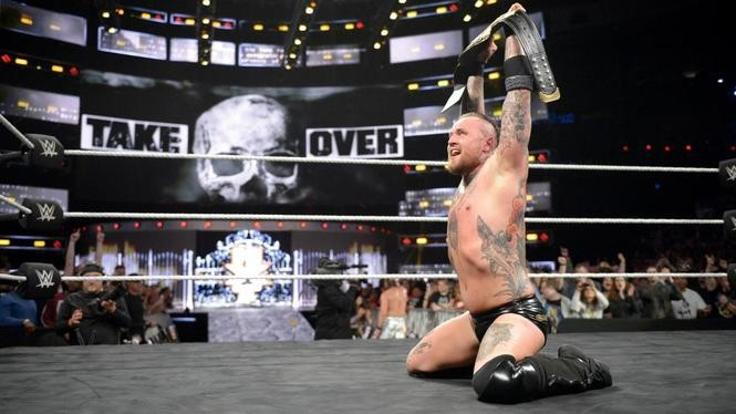 Aleister Black takes in the moment of becoming the new NXT champion.