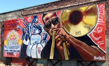 Brandan Odums' mural-advertisment portrait of Trombone Shorty