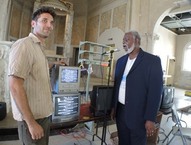 Artist Taylor Lee Shephard and Reverand Charles Duplessis experiment with 'Alterpiece,' a light sculpture made from 75 old-fashioned televisions (Photo by Doug MacCash / NOLA.com | The Times-Picayune)