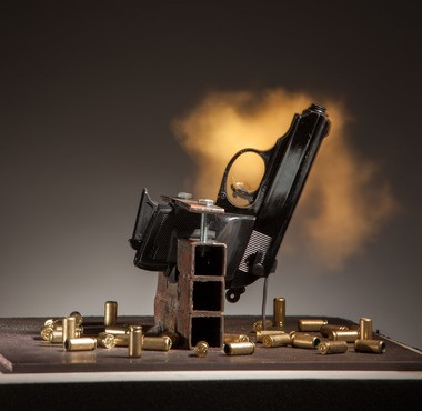 R. Luke Dubois' installation included a live handgun that loudly fired a blank whenever the police department announced a shooting (Photo by Neil Alexander, courtesy of Jonathan Ferrara Gallery)