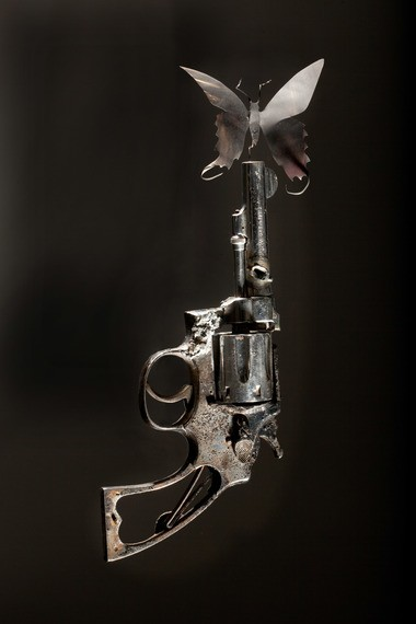 Paul Villinski's 'Mourn' includes a black steel butterfly emerging from a pistol barrel (Photo by Neil Alexander, courtesy of Jonathan Ferrara Gallery)