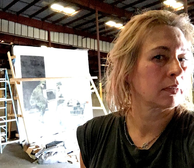 Conservator Elise Grenier with the Elysian Fields Avenue looters by Banksy (Photo courtesy Elise Grenier)