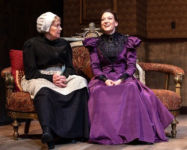 Nanny Anne Marie (Liann Pattison) listens as Nora (Jessica Podewell) describes the success she has achieved as a novelist, in 'A Doll's House, Part 2.' (John B. Barrois)