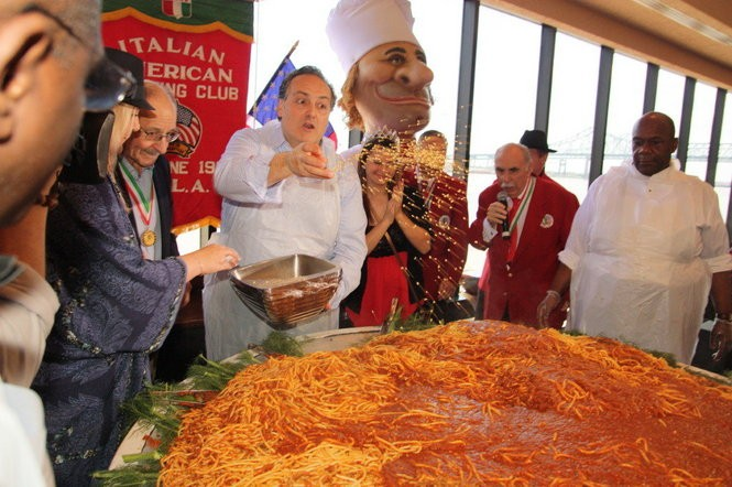 Chef Paul Grecco gets ready to serve from the world largest pasta dish at a recent pre-party for the annual St. Joseph's Day parade in New Orleans. (Photo from the Italian American Marching Club)