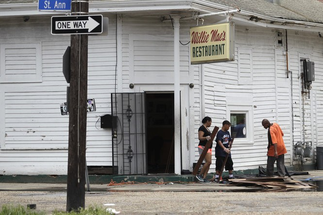 Clean-up is under way at Willie Mae Scotch House on St. Ann Street in New Orleans on Sunday, August 6, 2017, following an unexpectedly heavy rain on Saturday. (Photo by Chris Granger, NOLA.com | The Times-Picayune)