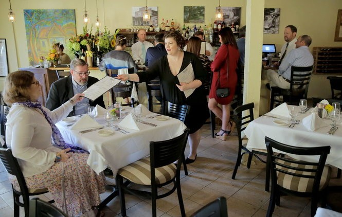 Gabie Sonnier, center, seats customers during the re-opening of Gabrielle restaurant in New Orleans on Wednesday, Sept. 27, 2017. The restaurant has been closed since it flooded in 2005. (Photo by Brett Duke, NOLA.com | The Times-Picayune)