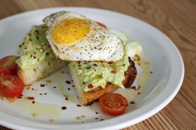 Avocado toast topped with an egg at The Daily Beet in New Orleans. (Photo by Todd A. Price, NOLA.com | The Times-Picayune)