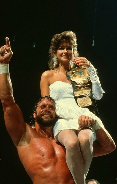 Randy Savage and Miss Elizabeth, his wife and manager, celebrate Savage winning the WWF championship in a 14-man tournament at WrestleMania IV.