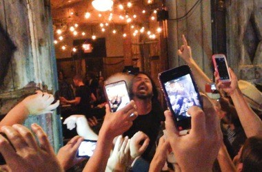 Fans outside Preservation Hall try to take a picture of the Foo Fighters' Dave Grohl during the band's surprise show on Saturday, May 17, 2014.