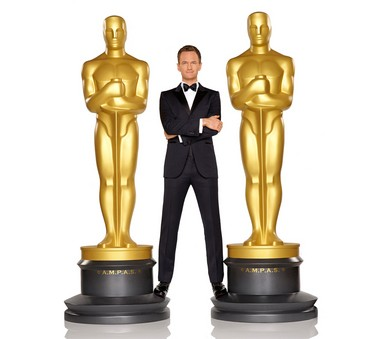 Actor Neil Patrick Harris poses with a pair of oversized Oscar statuettes. Patrick will host the 87th annual Academy Awards on Feb. 22, 2015.
