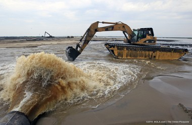 Sediment and water spew out of a pipe that is pumped in from the Mississippi River on the west bank of Plaquemines Parish on Tuesday, August 9, 2016. (Photo by Brett Duke, Nola.com   The Times-Picayune)