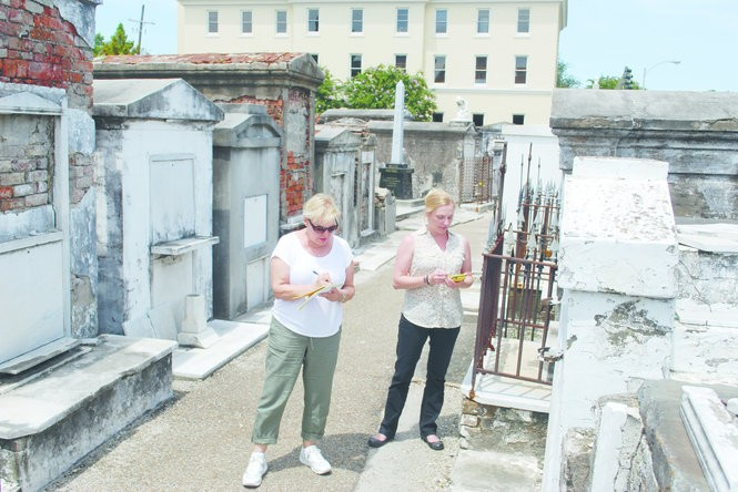 Authors Mary Manhein and Jessica Schexnayder conduct research at a New Orleans cemetery. Courtesy of University Press of Mississippi.