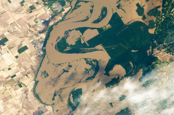 A May 12, 2011, photo taken from the International Space Station shows the Mississippi River spilling over its banks at Tomato, Ark., and in Tennessee. Flood control work along the Mississippi River and its tributaries has likely made floods worse in Mississippi and Louisiana, according to a study published April 4, 2018 in the journal Nature. (Photo by NASA via The Associated Press)