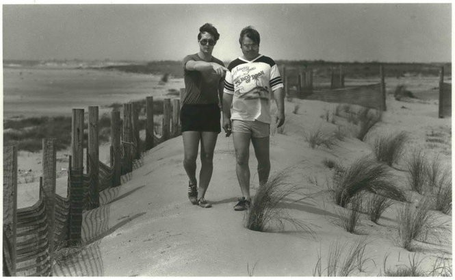 In 1986, Jim Edmonson and Bob Jones of Terrebonne Parish walk down a sand dune on a barrier island partially recreated with fences. The fences knock down blowing sand behind them, building dunes. (The Times-Picayune archive)