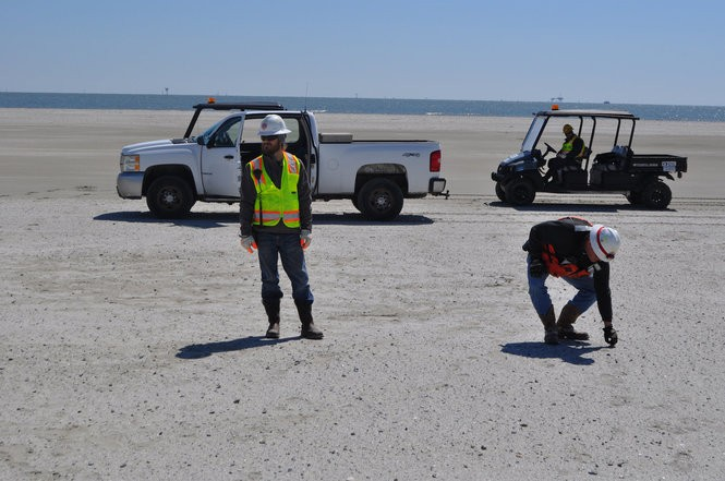 Restoration workers check on a new sand beach on Whiskey Island in Terrebonne Parish on March 14, 2018. (Tristan Baurick, NOLA.com | The Times-Picayune)