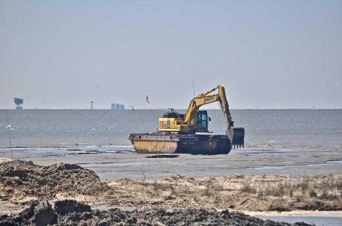 A backhoe sits on a newly-rebuilt sand beach on Whiskey Island in Terrebonne Parish on March 14, 2018. (Tristan Baurick, NOLA.com | The Times-Picayune)