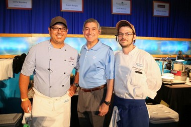 Louisiana Lt. Gov. Jay Dardenne, center, congratulates chef Aaron Burgau of Patois, left, and his assistant, Jonathan Lomonaco, on Burgau's victory in the Louisiana Seafood Cook-Off. Burgau's Crawfish and Pappardelle Pasta with Ramp Greens Puree and Uni Butter earned him the title King of Louisiana Seafood.