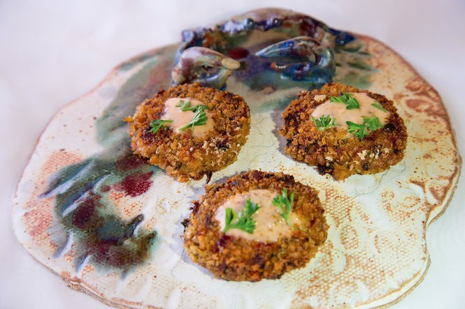 Crabcakes with 'Tiger Sauce' from 'Across the Table: Recipes & Stories from Two New Orleans Friends.' The sauce is one created by one of the book's co-author's daughter. (Photo by Ann Benoit and Thomas Dalferes)