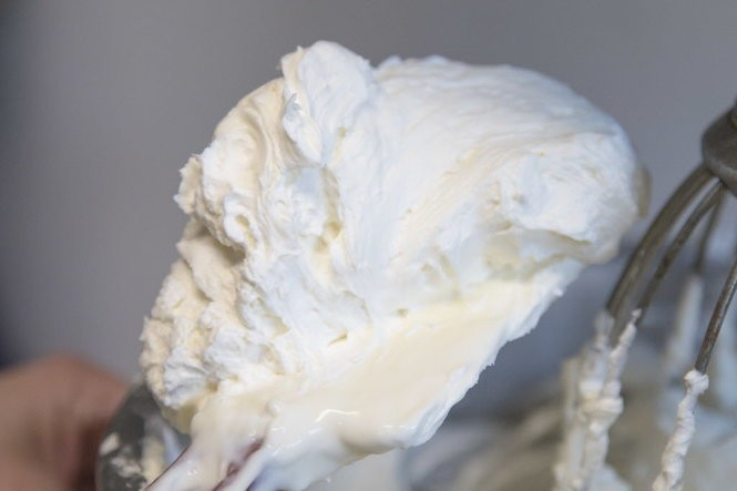 Once heavy cream is slowly added to the mascarpone and powdered sugar, switch from the paddle to whisk attachment and whip Chantilly cream icing just until it resembles mousse or whipped cream. (Photo by Christopher Edmunds, NOLA.com | The Times-Picayune)