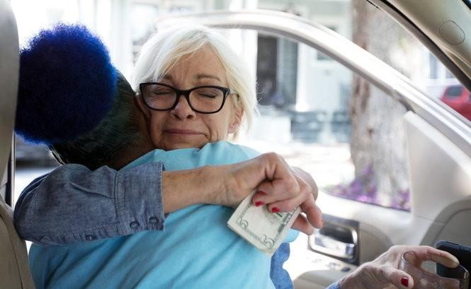 Sara Landrieu gives Ms. Okra a hug before buying produce on Saturday, April 28, 2018. (Photo by David Grunfeld, NOLA.com   The Times-Picayune)