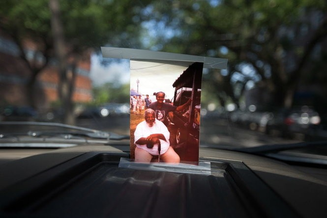 Sergio Robinson has a picture of herself and her father, Arthur 'Mr. Okra' Robinson, taped to the windshield of the colorfully painted pickup truck. (Photo by David Grunfeld, NOLA.com   The Times-Picayune)