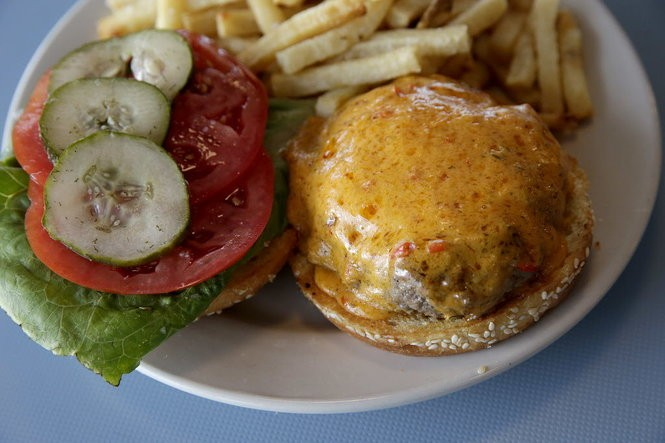 The High Hat Cafe's pimento cheeseburger is served with lettuce, tomato and pickles on the side with an order of fries. (Photo by Dinah Rogers, NOLA.com | The Times-Picayune archive)