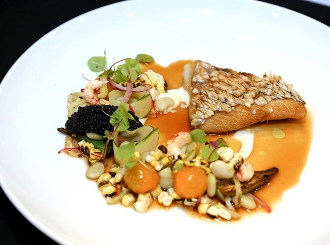 The winning was cracklin' crusted red snapper with pickled crawfish tails, buttermilk chili consomme, spring vegetables, burnt leek oil and bowfin caviar.