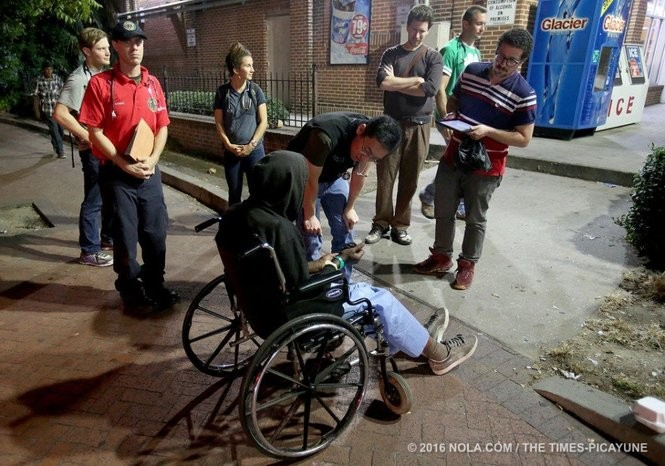 The street medicine team attends to a homeless man near Lee Circle.