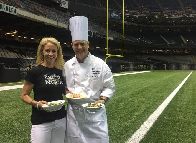 Dietician Molly Kimball stands with Superdome chef Lenny Martinsen. (Photo by Amanda Arbeit, courtesy of Eat Fit NOLA)