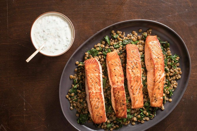 Pan-seared salmon with lentils and herbed yogurt sauce. See recipe below. (Photo by Carl Tremblay, America's Test Kitchen)
