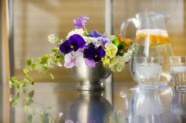 Designed by Margee Green of Cow Apple Horticulture Flower Farm, this arrangement features pansies, scabiosa, sweet alyssum, viola, vinca vine and yellow garden roses.