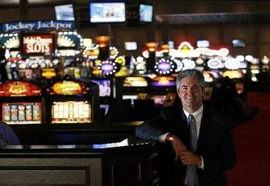 Former Fair Grounds president Austin Miller stands in the new 33,000-square foot slots facility that opened in 2008.
