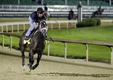 Exercise rider Joel Barrientos takes Kentucky Derby entrant Vicar's in Trouble for a morning workout at Churchill Downs Thursday, May 1, 2014, in Louisville, Ky. (AP Photo/Morry Gash)
