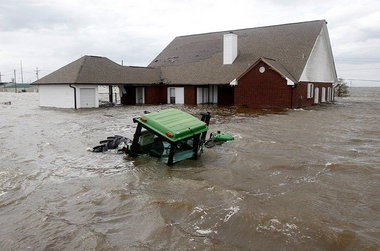 The swirling flood water from Hurricane Isaac inundate a home and tractor in Myrtle Grove in Plaquemines Parish Thursday, Aug. 30, 2012. Hurricane Isaac made landfill on Aug. 28.