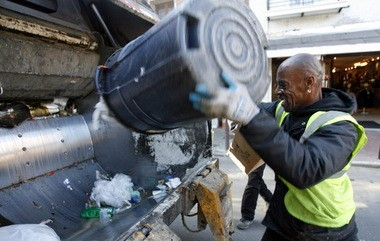 Cornelius Washington, garbage collector extraordinaire, dumps a can while working Decatur Street in the French Quarter, on Feb. 16, 2007. (Photo by Michael DeMocker, NOLA.com | The Times-Picayune)